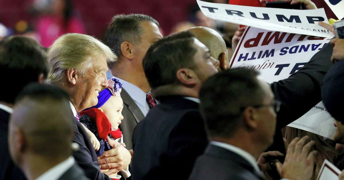 Republican presidential candidate Donald Trump holds a baby during a rally in Charleston, W.Va., Thursday.