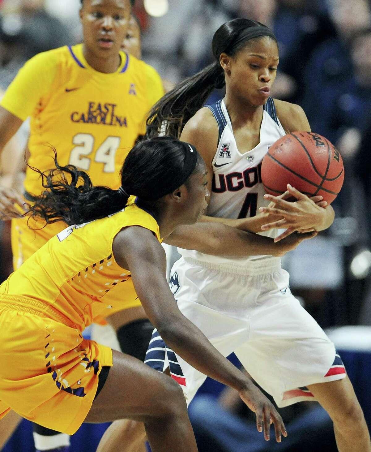 UConn's Moriah Jefferson, right, steals the ball from East Carolina's Khadidja Toure.
