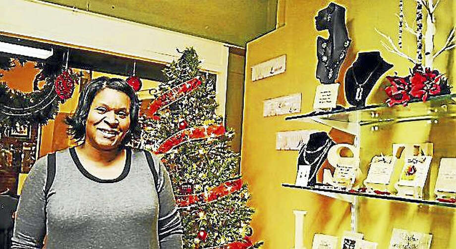Dorene Robles, owner of Verse-A-Tile in Middletown, said her New Year's resolution is to help others reach their full potential Photo: Sam Norton — The Middletown Press