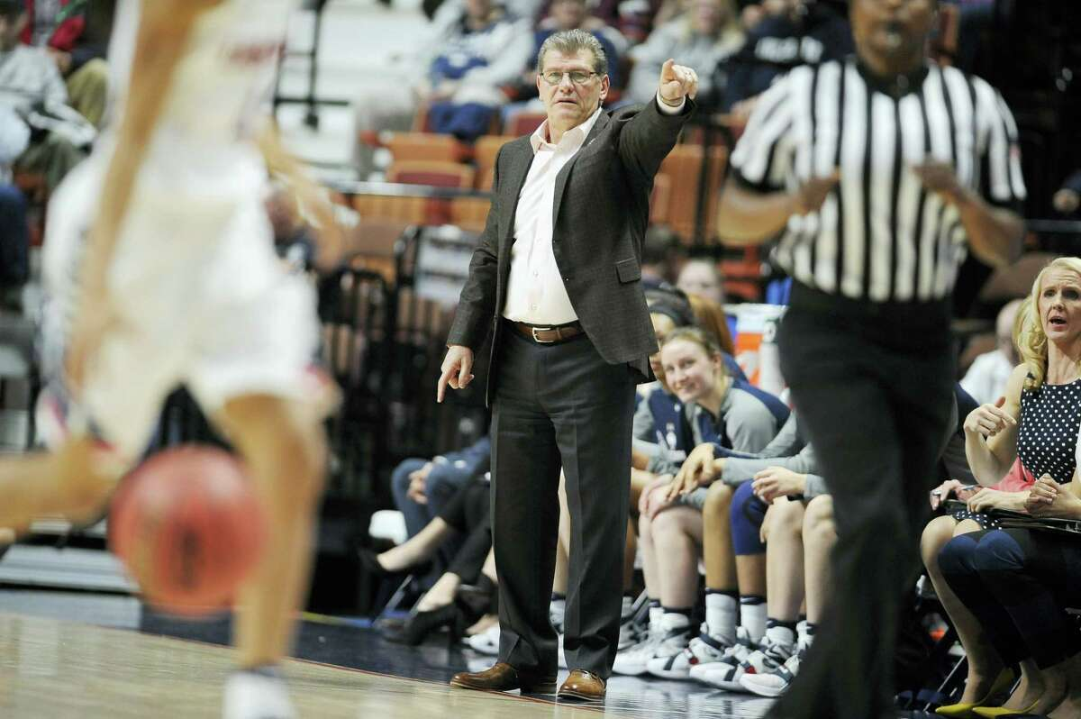 UConn head coach Geno Auriemma calls out to his team during the first half of Saturdy's AAC quarterfinal game at Mohegan Sun Arena in Uncasville.