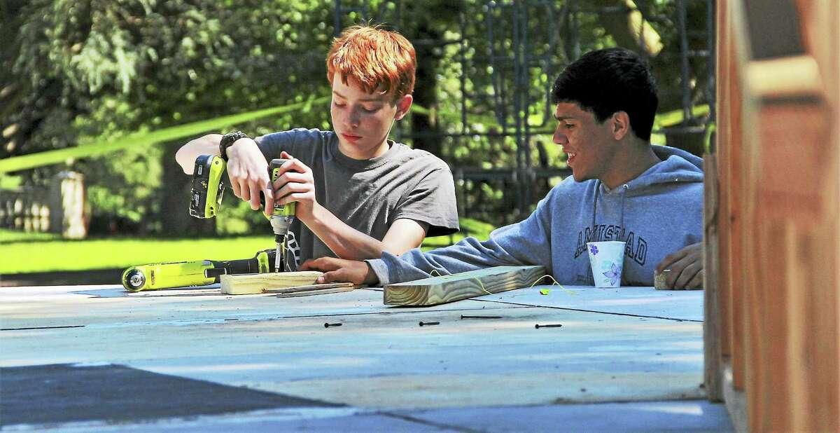 "Elm Scholars help assemble the sets in Edgerton Park for the recent run of ""A Midsummer Night's Dream."""