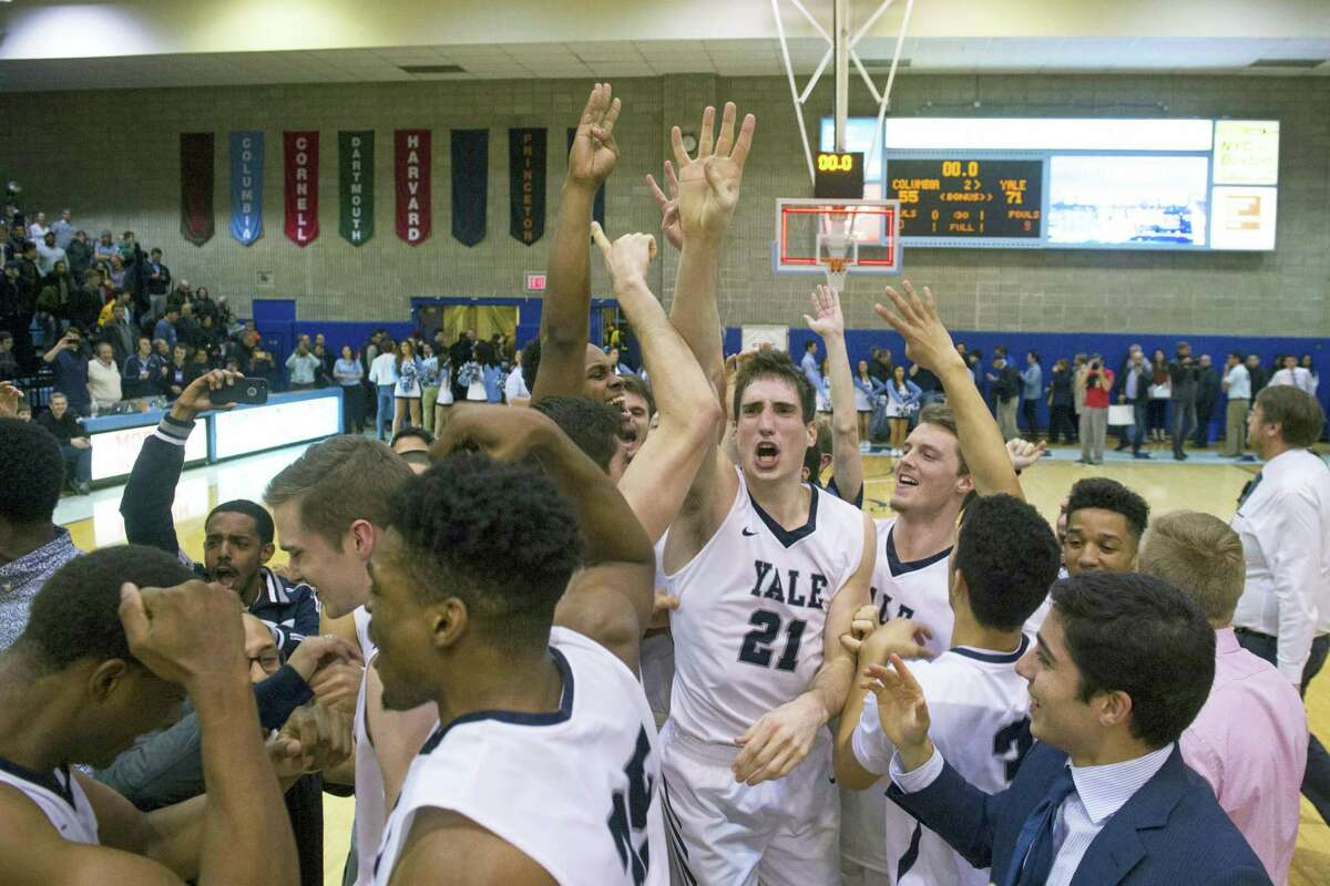 Yale guard Nick Victor (21) celebrates the win at the end of the second half of an NCAA Ivy League Conference college basketball game Saturday, March 5, 2016, in New York. Yale beat Columbia 71-55. (AP Photo/Bryan R. Smith)