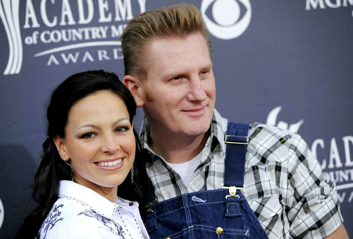 """In this April 3, 2011, file photo, Joey Martin Feek, left, and husband Rory Lee Feek, of """"Joey + Rory,"""" arrive at the Annual Academy of Country Music Awards in Las Vegas, Nev. Joey died Friday, March 4, 2016, her manager said. Feek, who had been diagnosed with cancer two years ago, died at home in Indiana, Aaron Carnahan said."""
