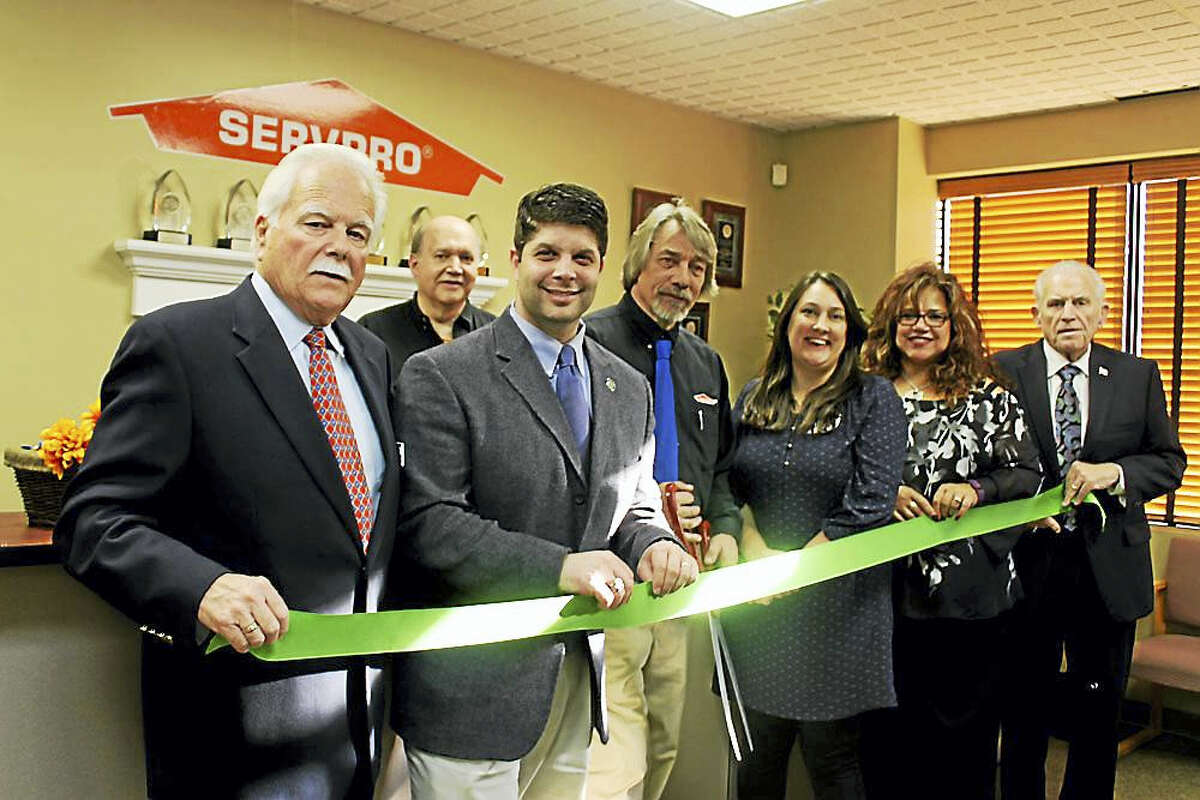 SERVPRO of Middletown/New Britain held a business expansion and 10-year anniversary celebration Nov. 2 at their location in Middletown. From left are Middletown Small Business Development Counselor Paul Dodge, Owner of SERVPRO of Middletown/New Britain Gary Edwards, Middletown Mayor Dan Drew, general manager Alfred Conroy, office manager Jennifer Waldron, accounts liaison Marie Leavitt and Middlesex County Chamber of Commerce President Larry McHugh.