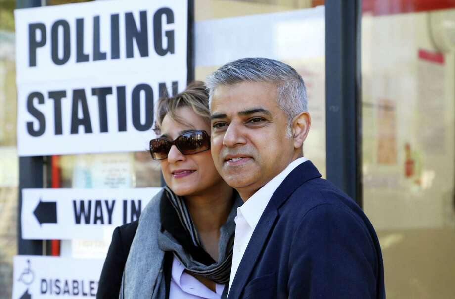 London mayoral candidate Labour Party's Sadiq Khan arrives with his wife Saadiya to cast their votes at a polling station in Streatham, south west London. Photo: Philip Gareth Fulller — PA Via AP  / PA