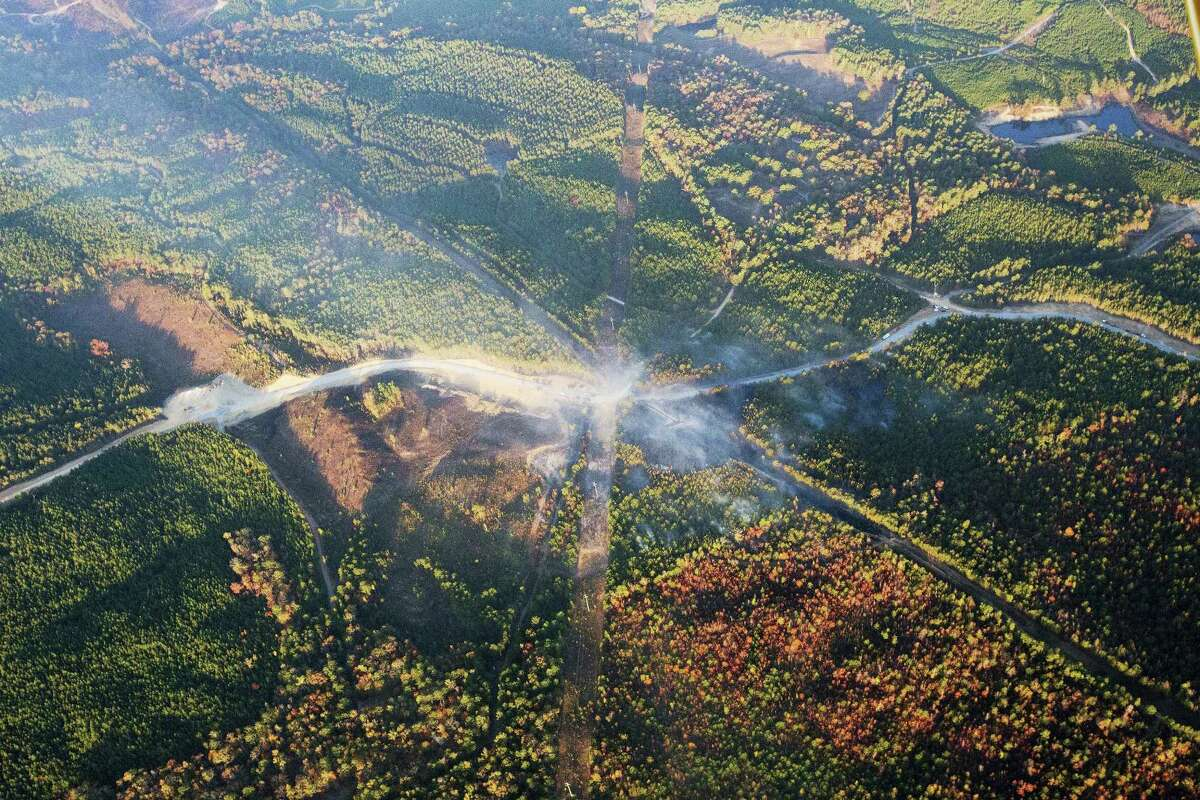 A fog of smoke covers the trees near an explosion of a Colonial Pipeline on Nov. 1, 2016 in Helena, Ala. The pipeline explosion occurred on Monday. The blast, which sent flames and thick black smoke soaring over the forest, happened about a mile west of where the pipeline ruptured in September, Gov. Robert Bentley said in a statement.