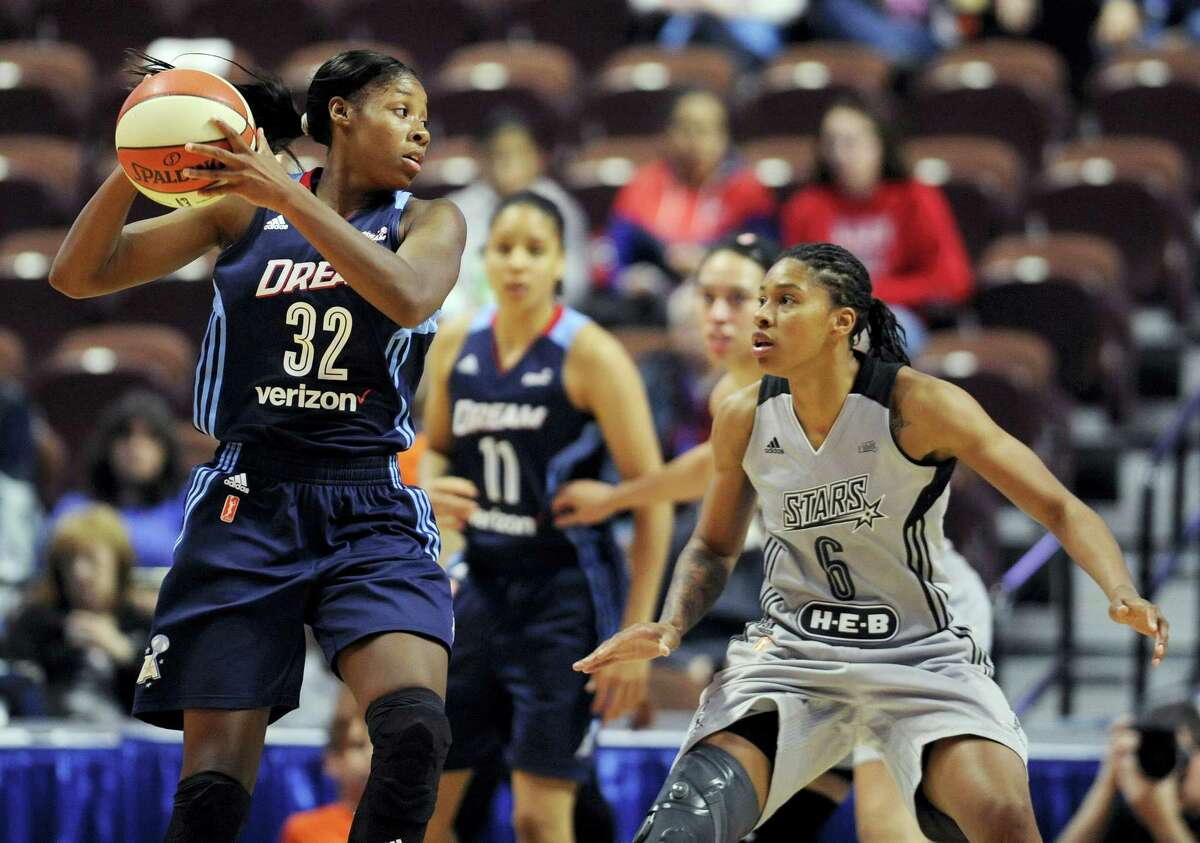 Atlanta Dream's Bria Holmes looks to pass around San Antonio Stars' Alex Montgomery, right, during the second half of a WNBA basketball game, Wednesday, May 4, 2016, in Uncasville, Conn. (AP Photo/Jessica Hill)