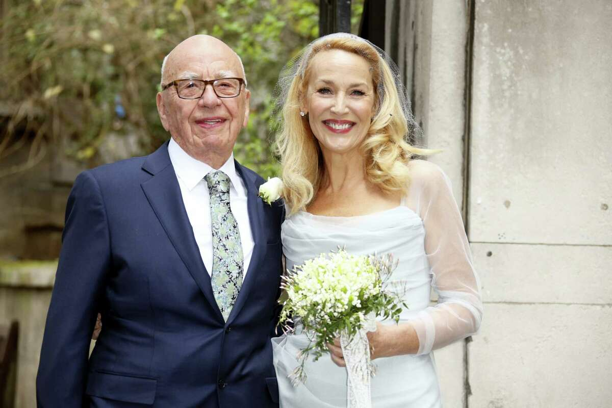 Rupert Murdoch, left, and Jerry Hall leave St Bride's Church after the celebration ceremony of the wedding of Rupert Murdoch and Jerry Hall in London, Saturday, March 5, 2016.