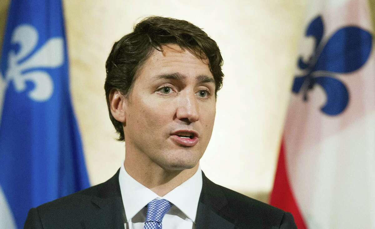 """In this Jan. 26, 2016 file photo, Canadian Prime Minister Justin Trudeau speaks during a news conference in Montreal, following his meeting with Montreal mayor Denis Coderre. Trudeau says Canadians would appreciate it if Americans paid more attention to what's going on around the globe. Trudeau said in a 60 Minutes interview to be aired Sunday, March 6, 2016, that """"it might be nice if they paid a little more attention to the world."""""""