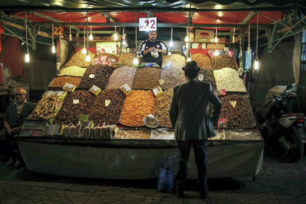 A man shops for dry fruits at a stall in the landmark Jemaa el-Fnaa square and market, in Marrakesh, Morocco on Nov. 5, 2016. The Climate Conference, known as the COP22, starts Monday in Marrakech and is expected to attract hundreds of participants and state representatives.