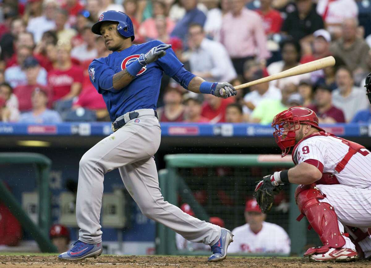 In this June 6, 2016, file photo, Chicago Cubs' Addison Russell bats against the Philadelphia Phillies. The Chicago Cubs became the first team since the 1976 Cincinnati Reds' Big Red Machine to have five players voted as All-Star Game starters when their entire infield earned the honor Tuesday along with center fielder Dexter Fowler. First baseman Anthony Rizzo, second baseman Ben Zobrist, shortstop Russell and third baseman Kris Bryant also were elected. The only other team to start four infielders was the 1963 St. Louis Cardinals.