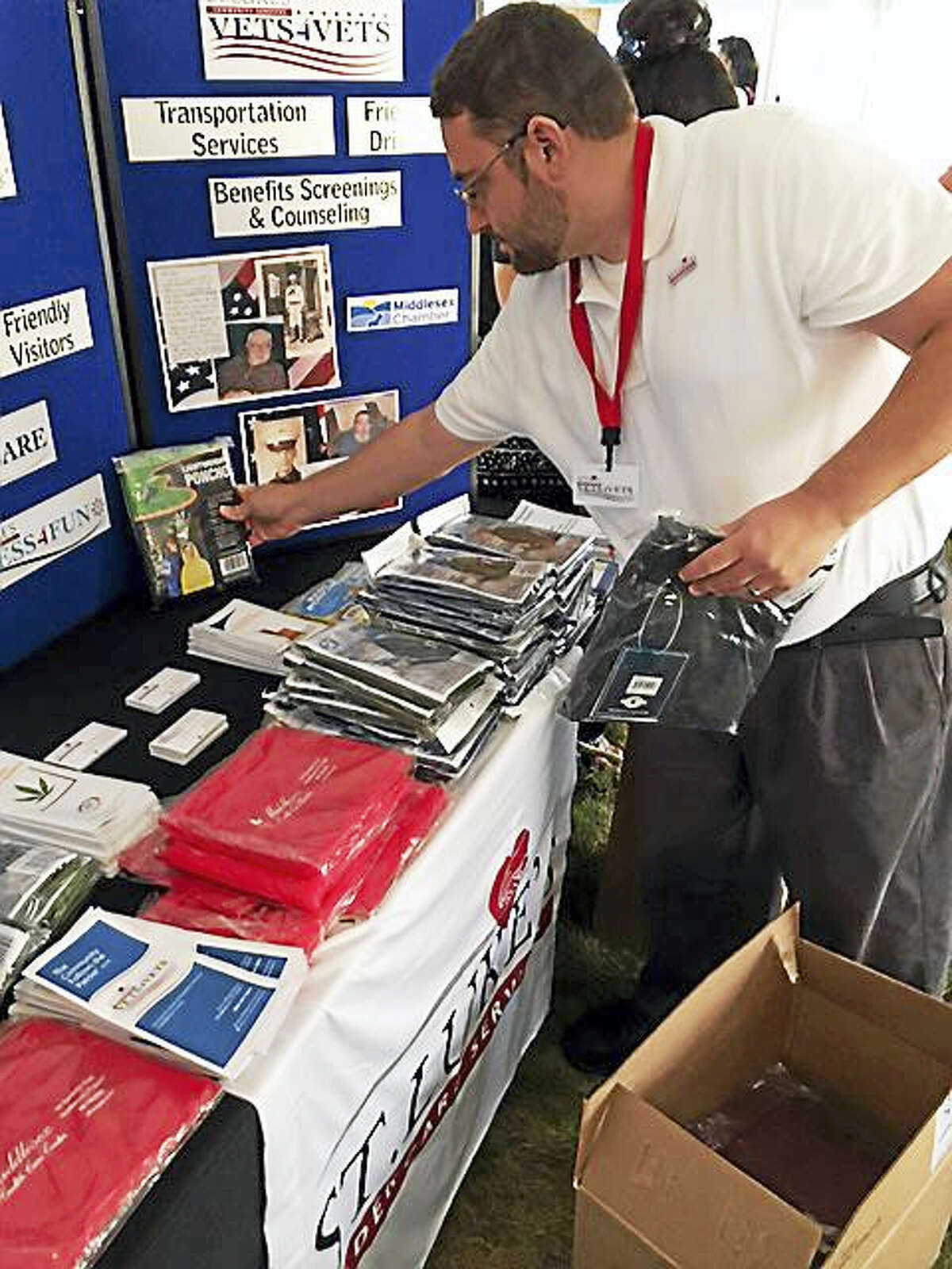 Volunteers for St. Luke's Vets4Vets program helped provide transportation to the 2015 Operation Stand Down event for homeless veterans at the Connecticut Veterans Home, Rocky Hill. Volunteers helped to distribute 500 ponchos to vets.