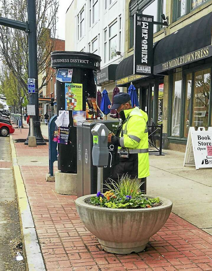 The Common Council approved two new changes to ordinances that would eliminate the city's parking fund and also increase the penalty charges for paying fines late. After one week, a parking ticket will double to $20 and after two weeks, it will reach a maximum fine of $40. Photo: Sam Norton — The Middletown Press