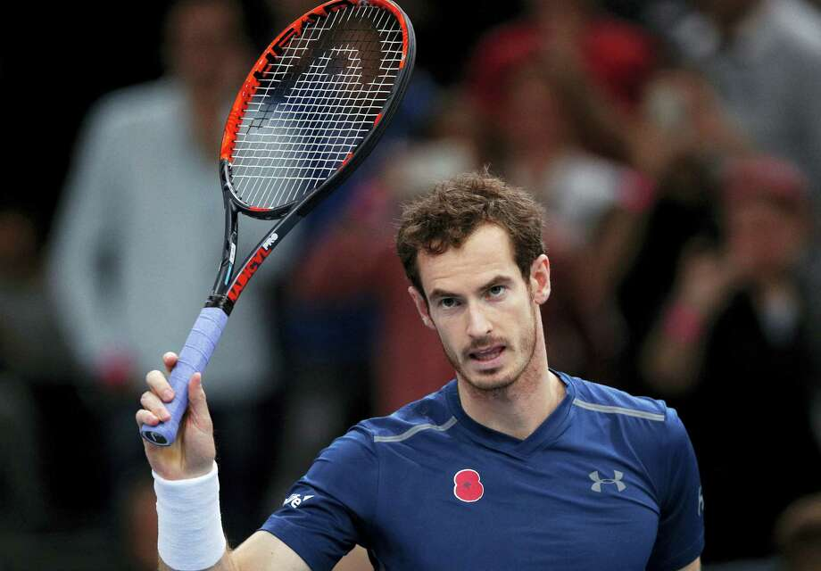 Britain's Andy Murray waves to fans as he arrives for a training session during the Paris Masters tennis tournament on Saturday. Photo: Christophe Ena — The Associated Press  / Copyright 2016 The Associated Press. All rights reserved.