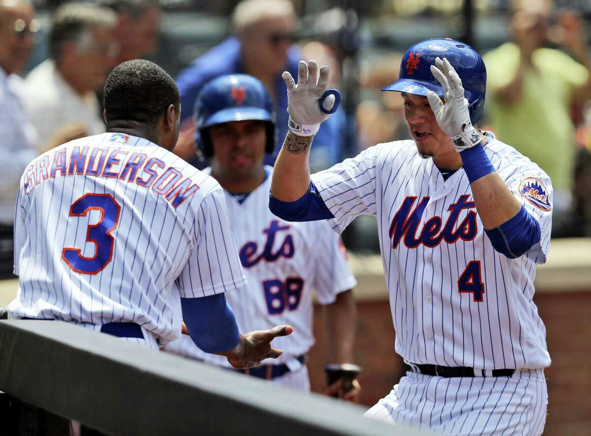 Wilmer Flores, right, celebrates his homer with Curtis Granderson during the fourth inning at Citi Field Wednesday. The nEW yORK Mets defeated the mIAMI Marlins 4-2.