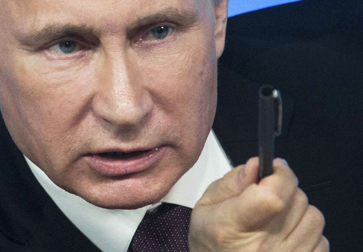 Russian President Vladimir Putin gestures during a news conference in Moscow, Russia.