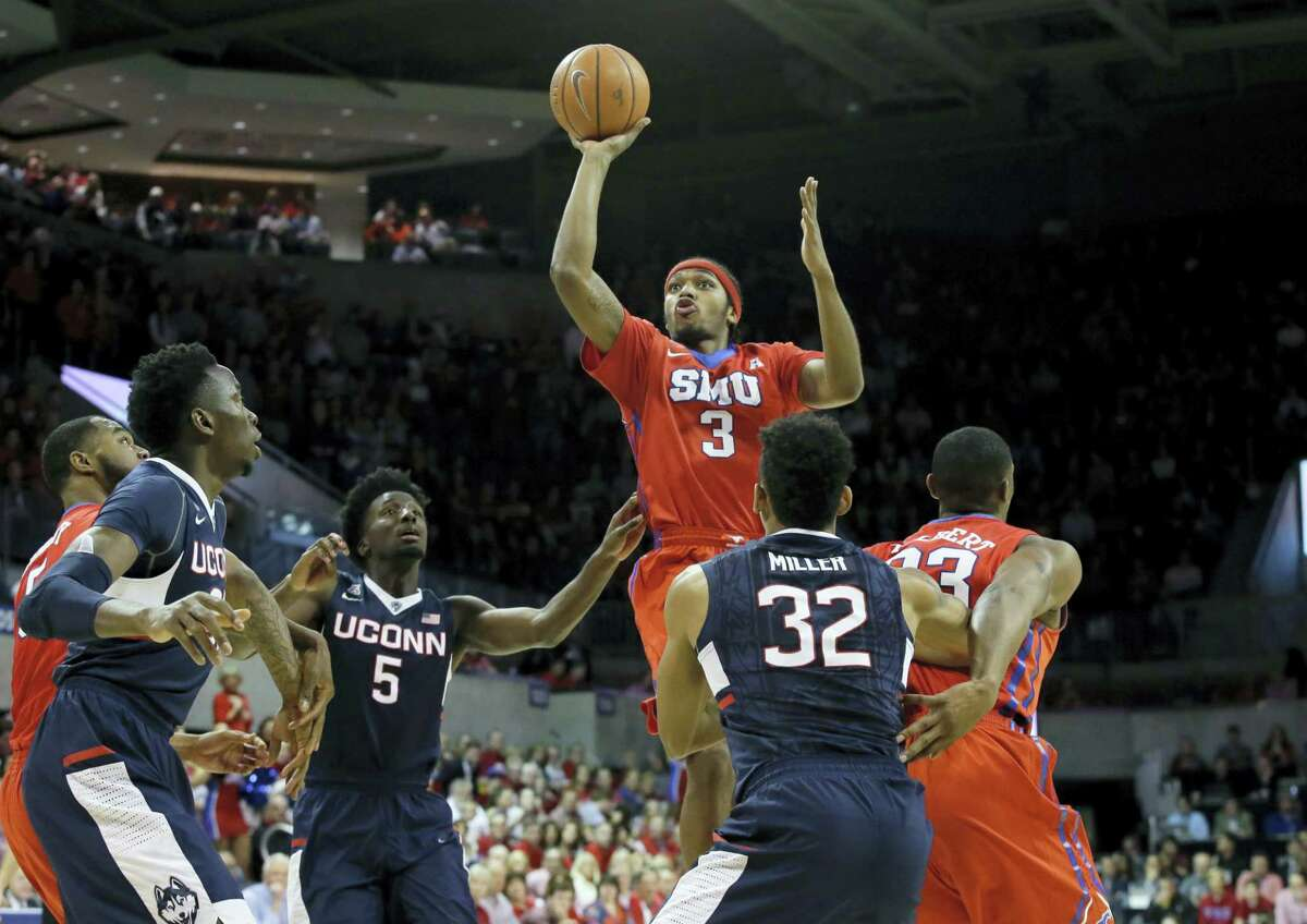 SMU guard Sterling Brown (3) shoots over traffic during the first half against UConn Thursday in Dallas.