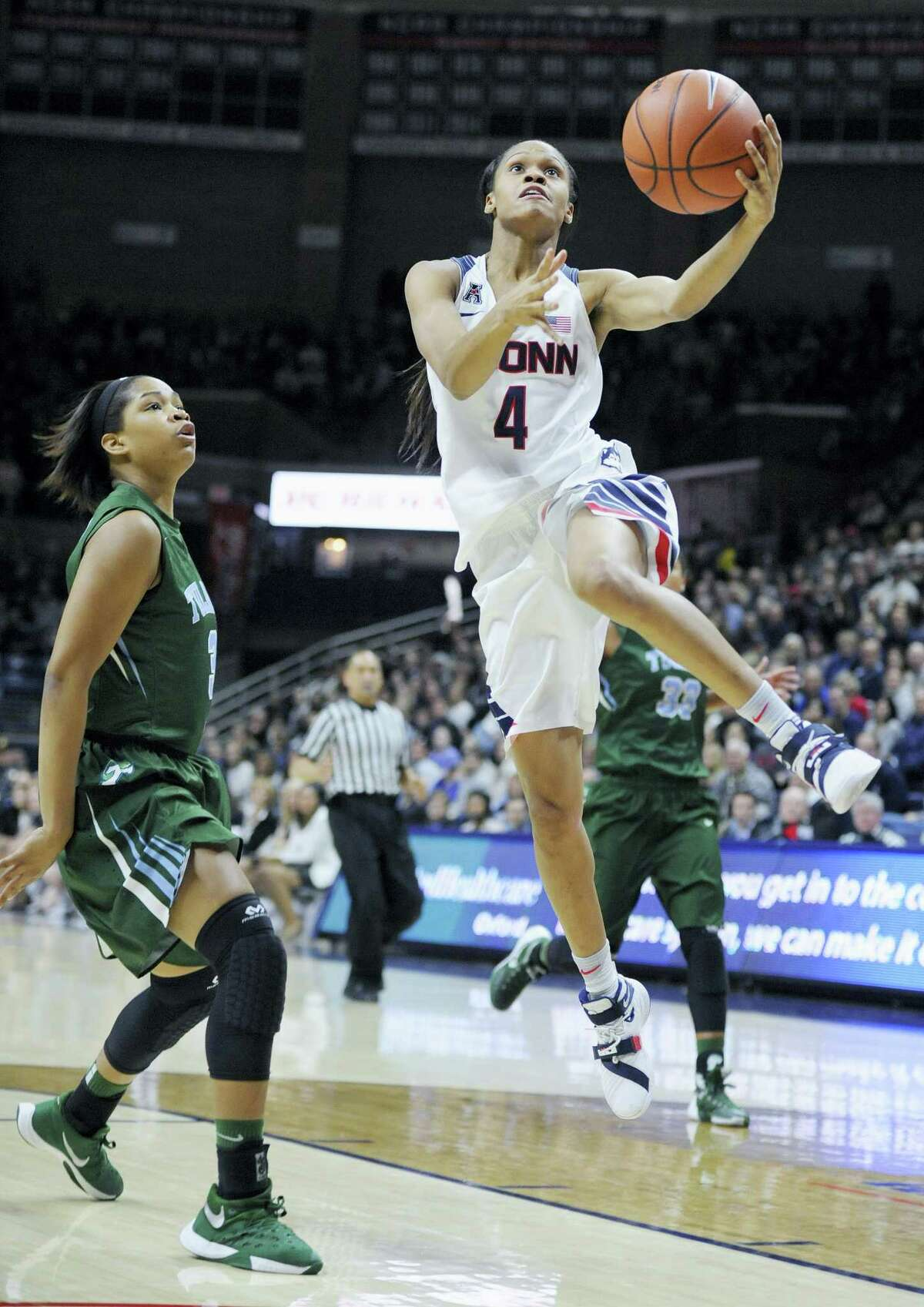 Connecticut's Moriah Jefferson, driving to the basketball against Tulane's Kolby Morgan, was named the AAC's Defensive Player of the Year.