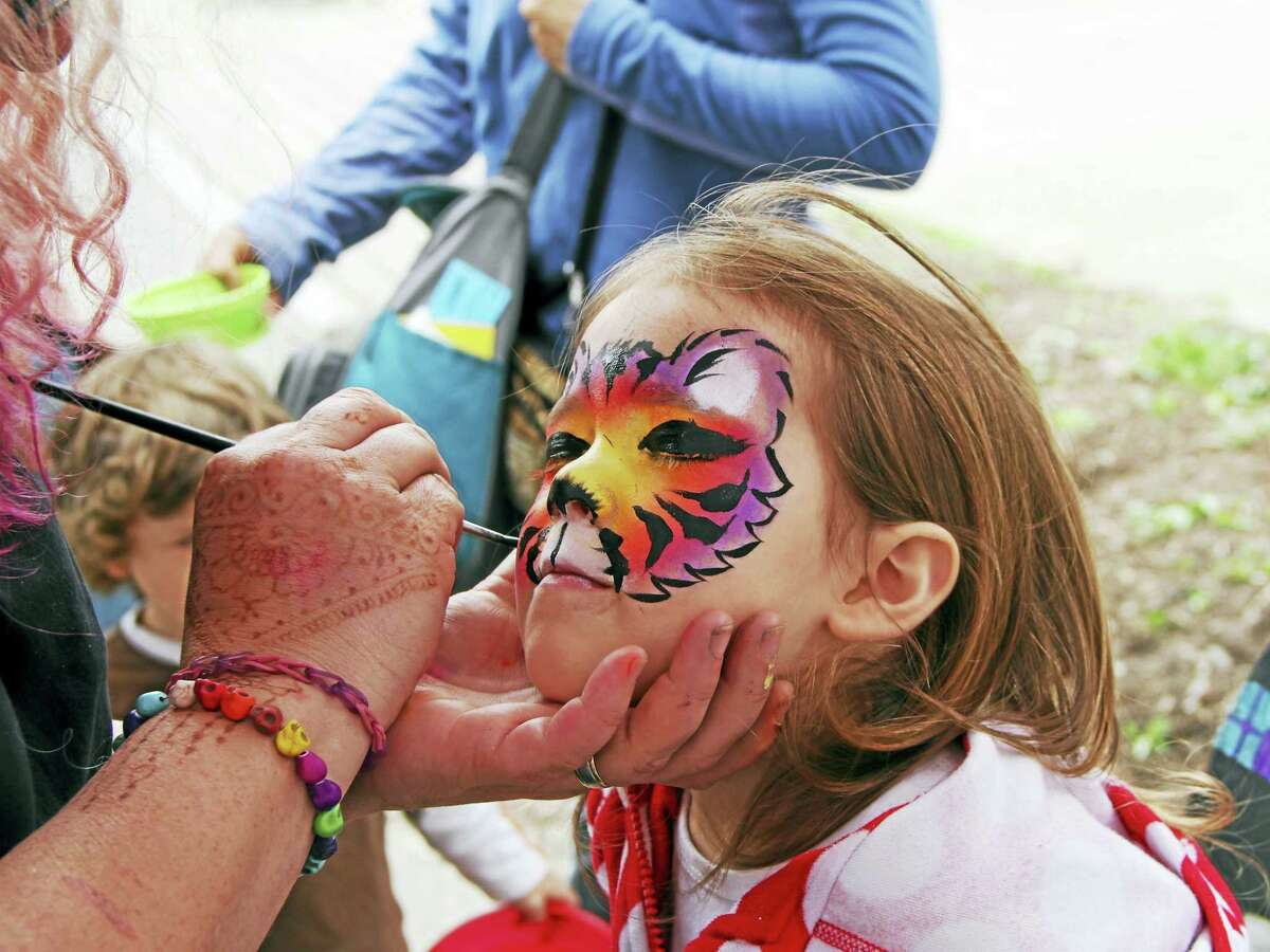 Elaborate face painting and henna are popular with kids of all ages.