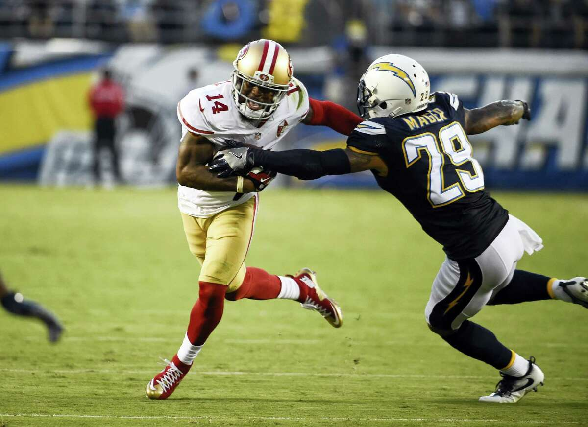 San Francisco 49ers wide receiver Eric Rogers, left, pushes off San Diego Chargers cornerback Craig Mager during the first half of an NFL preseason football game on Sept. 1, 2016 in San Diego.