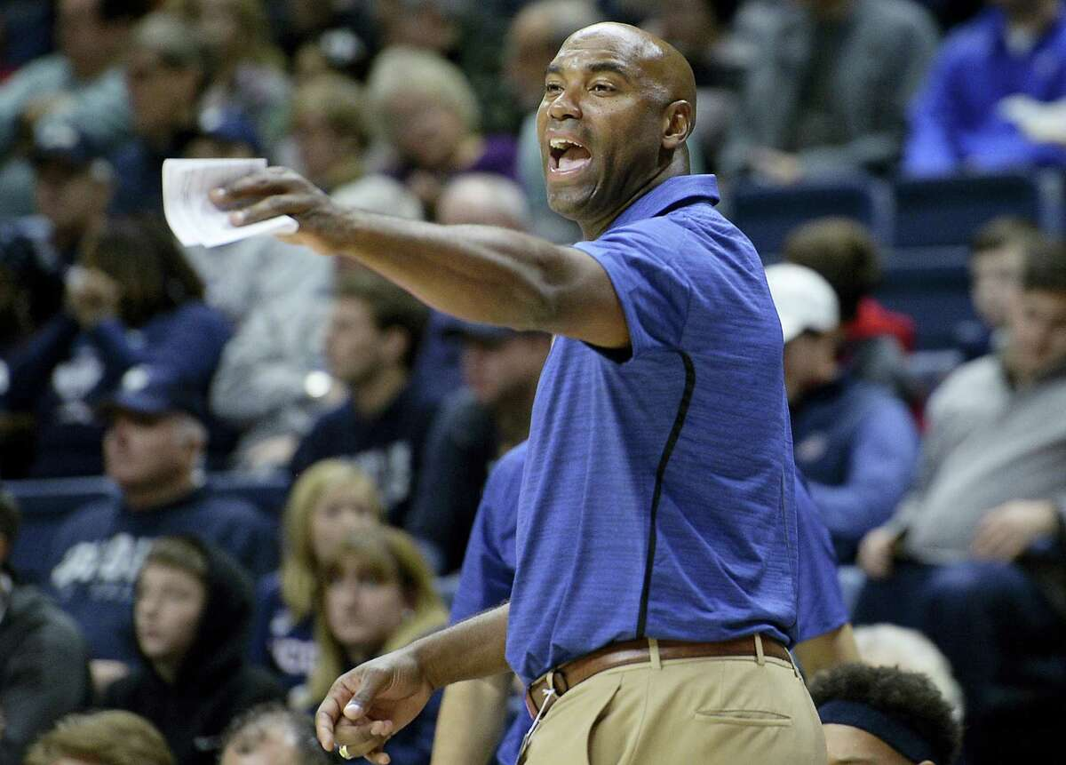 SCSU head coach Scott Burrell reacts in the first half of Saturday's exhibition game against UConn.