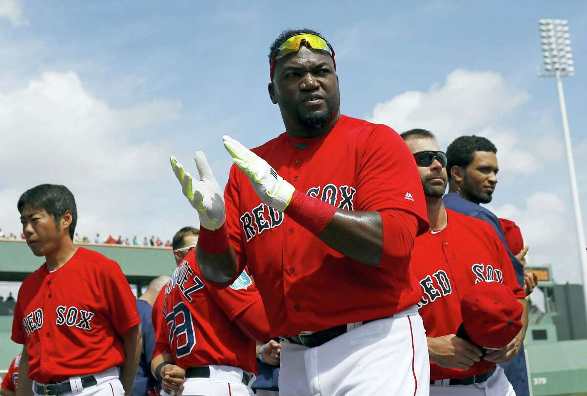 Red Sox designated hitter David Ortiz, center, walks on the field before Friday's spring training game against the Rays.
