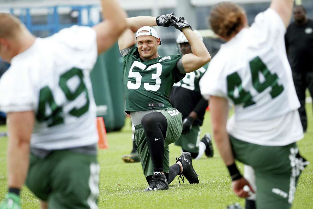 New York Jets defensive end Mike Catapano stretches during a recent practice.