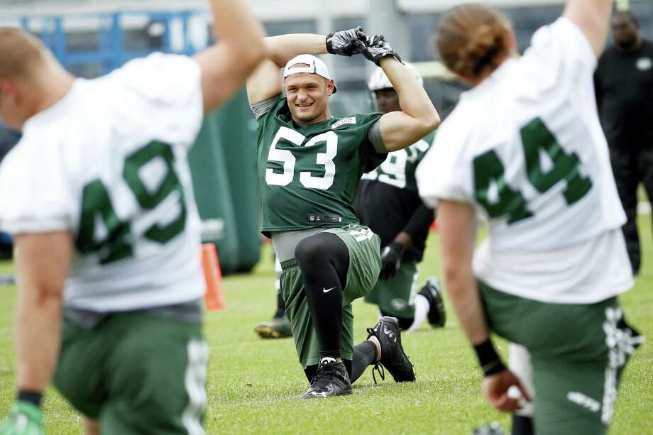 New York Jets defensive end Mike Catapano stretches during a recent practice. Photo: The Associated Press File Photo  / Copyright 2016 The Associated Press. All rights reserved.