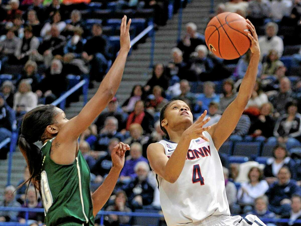 Connecticut's Moriah Jefferson (4) drives past South Florida's Courtney Williams (10) during the first half of their matchup earlier this season.