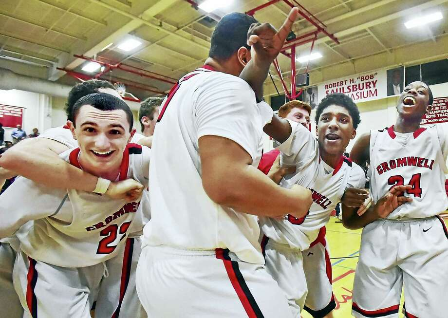 The Cromwell Panthers celebrate their 52-48 win over the Lyme-Old Lyme Wildcats in the Shoreline Conference championship, Friday, March 4, 2016, at the Robert H. Saulsbury Gymnasium at Wilbur Cross High School in New Haven. (Catherine Avalone/New Haven Register) Photo: Journal Register Co.