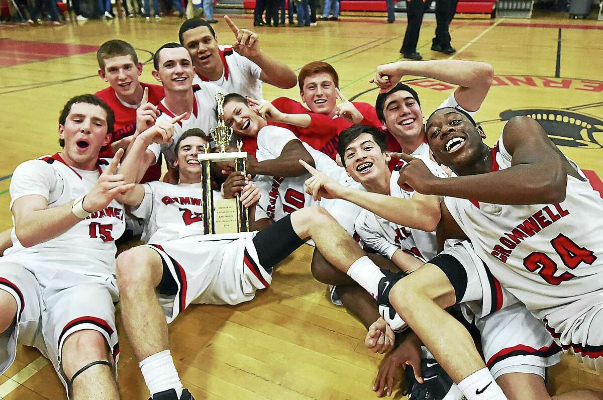 The Cromwell Panthers celebrate their 52-48 win over the Lyme-Old Lyme Wildcats in the Shoreline Conference championship, Friday, March 4, 2016, at the Robert H. Saulsbury Gymnasium at Wilbur Cross High School in New Haven. (Catherine Avalone/New Haven Register)