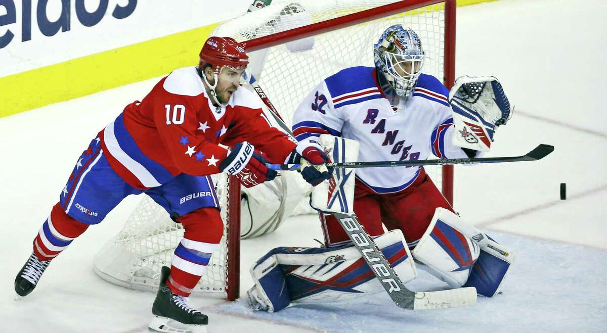 Washington Capitals center Mike Richards (10) reaches to deflect the puck as New York Rangers goalie Antti Raanta (32), from Finland, prepares to make the save, in the third period Friday in Washington. The Rangers won 3-2.