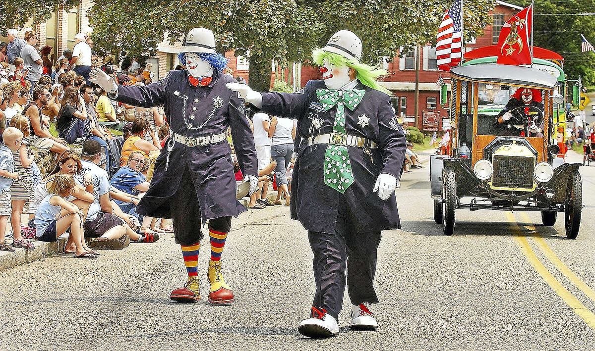 Members of the Funsters Sphinx Shriners, Fizz-Bo and Bubbles, march in the East Hampton Old Home Days Parade.