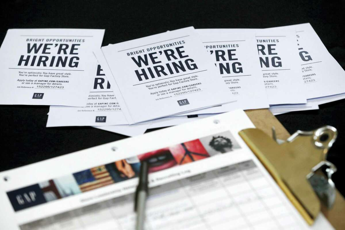 In this Tuesday, Oct. 6, 2015, file photo, job applications and information for the Gap Factory Store sit on a table during a job fair at Dolphin Mall in Miami. Fewer Americans applied for unemployment benefits last week of Aug. 2016, another sign the U.S. job market remains healthy despite a downshift in hiring in August. The Labor Department says the number of applications for jobless aid slid by 4,000 last week to a seasonally adjusted 259,000, lowest since mid-July.