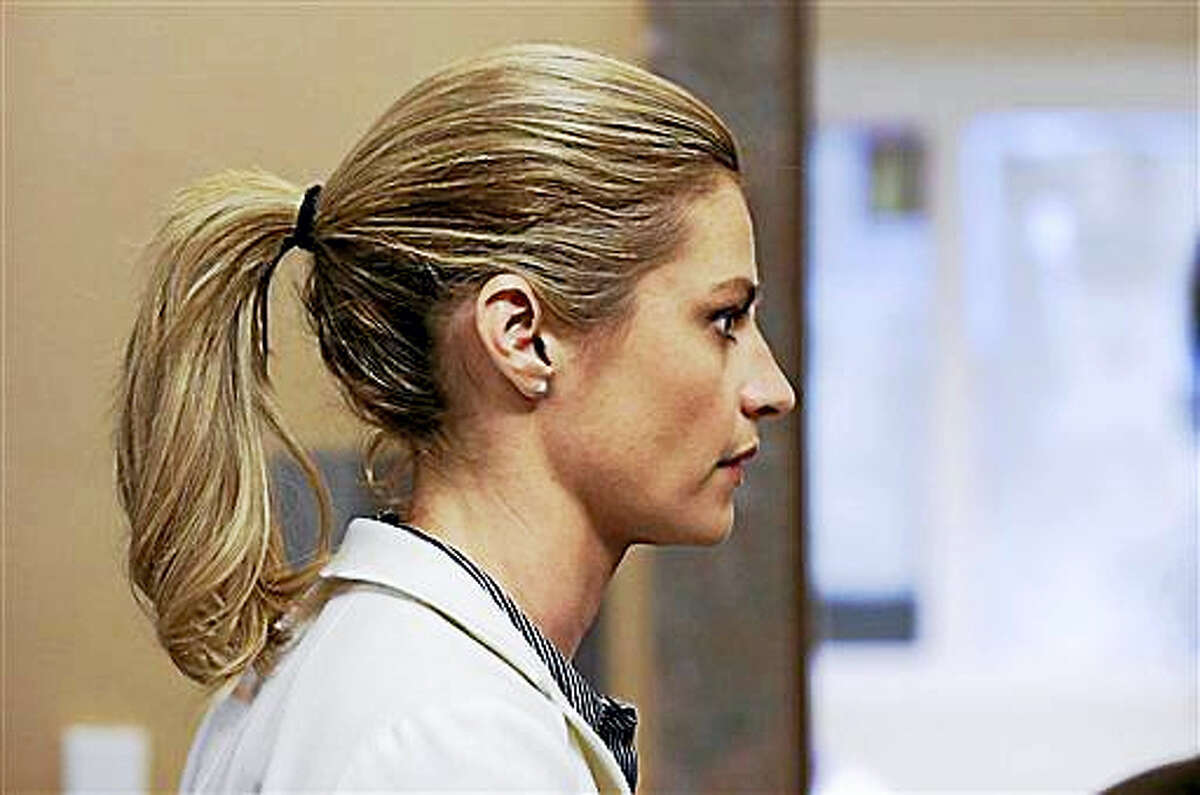 Sportscaster and television host Erin Andrews walks to the courtroom after a lunch break Thursday, March 3, 2016, in Nashville, Tenn. Andrews has filed a $75 million lawsuit against the franchise owner and manager of a luxury hotel and a man who admitted to making secret nude recordings of her in 2008.