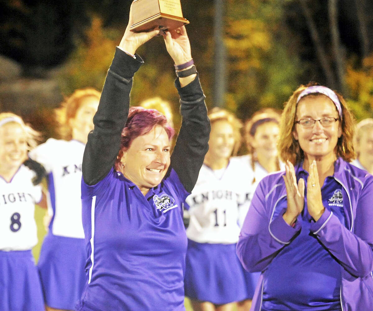 Westbrook field hockey coach Janet Dickey, holding the trophy, and assistant coach Emily Alger celebrate after the Knights' 1-0 win over Valley Regional Thursday night in Clinton.