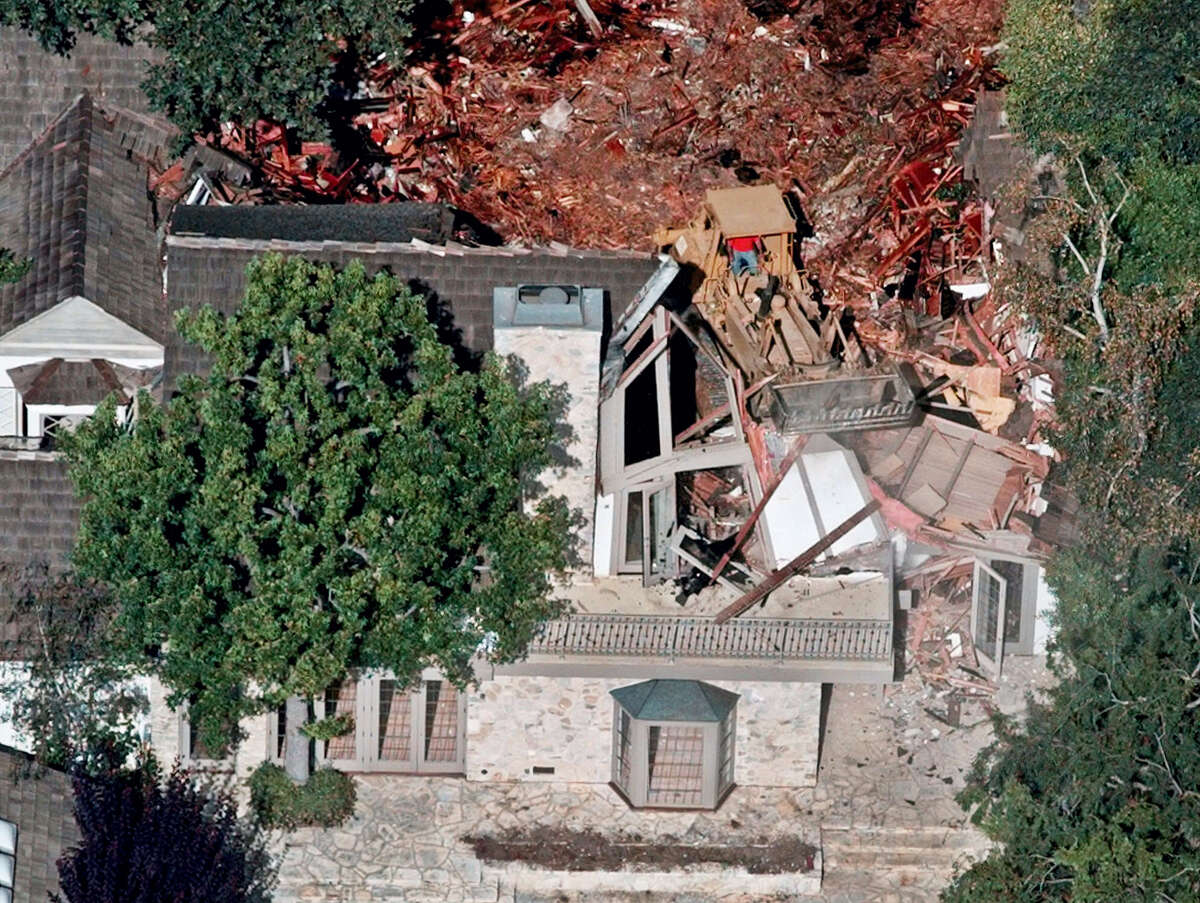 FILE: Crews demolish the former home of O.J. Simpson, Wednesday, July 29, 1998, in the Brentwood area of Los Angeles. Detectives are investigating a knife purportedly found some time ago at the former home of O.J. Simpson, who was acquitted of murder charges in the 1994 stabbings of his ex-wife Nicole Brown Simpson and her friend Ron Goldman, Neiman said Friday.