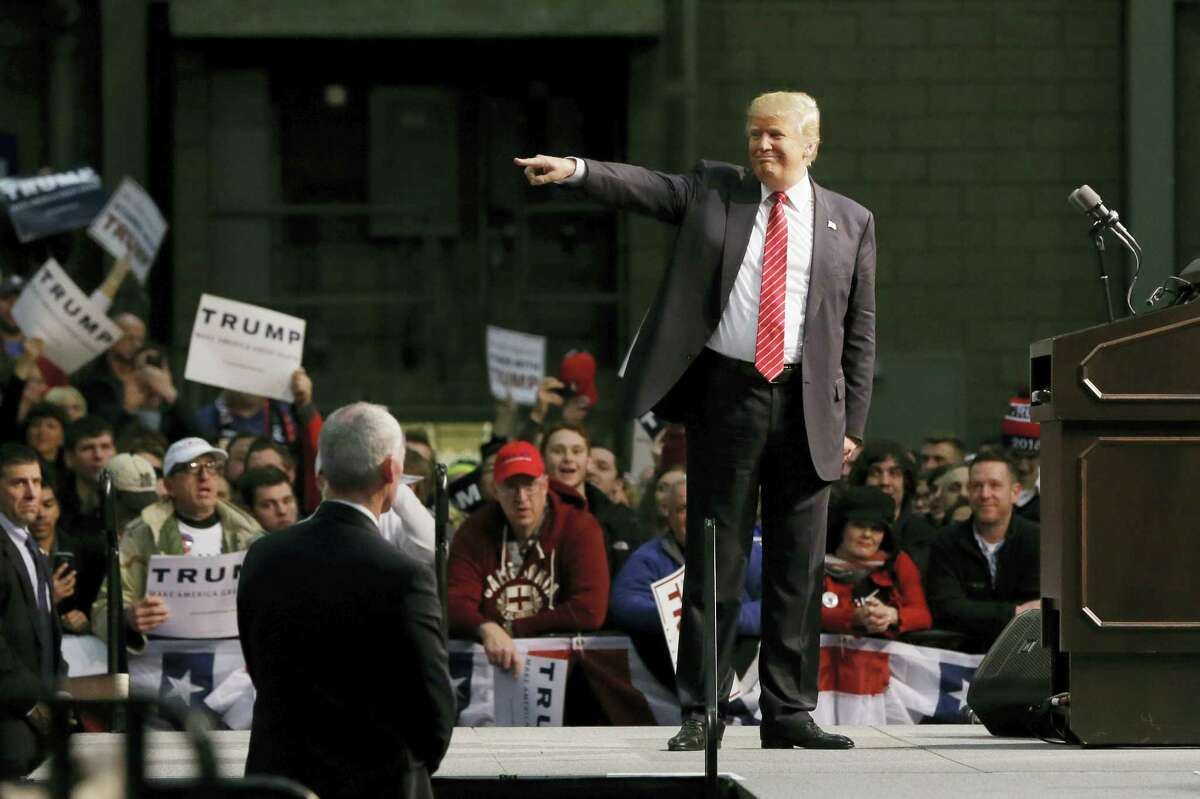 Republican presidential candidate Donald Trump acknowledges the crowd during a rally Friday at Macomb Community College in Warren, Michigan.