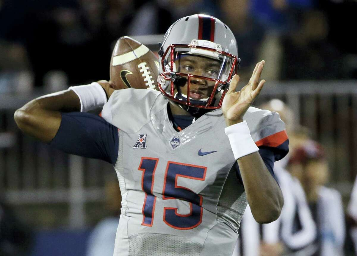 UConn quarterback Donovan Williams passes the ball during the first half.