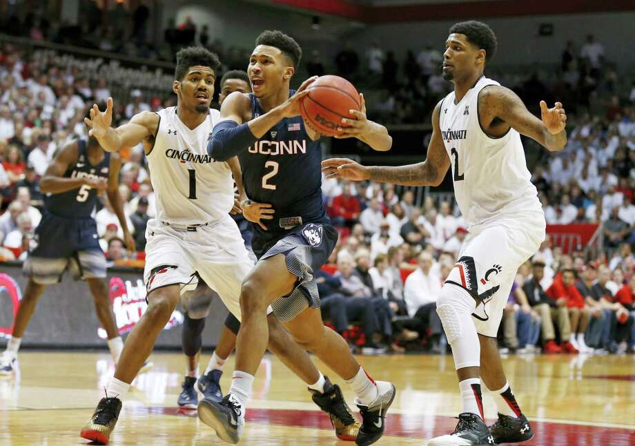 UConn guard Jalen Adams, center, drives to the basket during a recent game. Photo: The Associated Press File Photo  / FR171284 AP