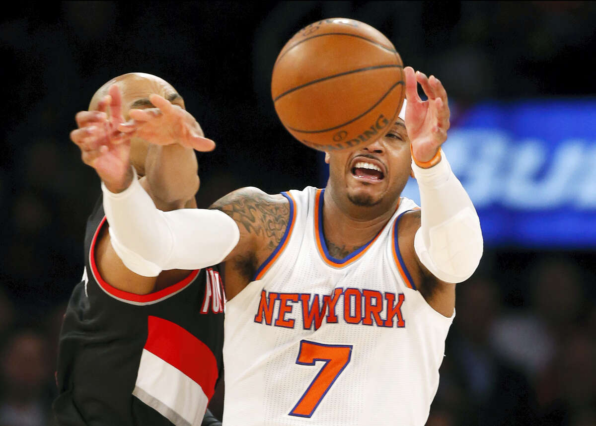 Portland Trail Blazers guard Gerald Henderson knocks the ball from the hands of New York Knicks forward Carmelo Anthony (7) during the first half Tuesday at Madison Square Garden.