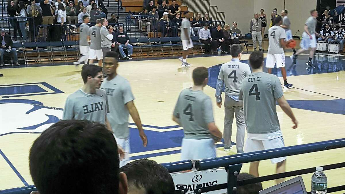 Yale basketball players wearing shirts in support of their teammate Jack Montague.