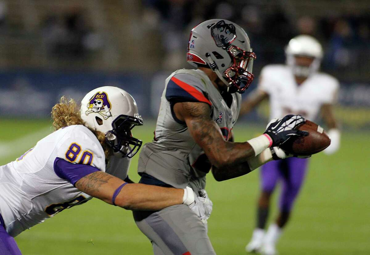 Connecticut center Jamar Summers, right, intercepts a pass intended for East Carolina tight end Bryce Williams (80) during the second quarter of an NCAA college football game, Friday, Oct. 30, 2015, in East Hartford, Conn. (AP Photo/Stew Milne)