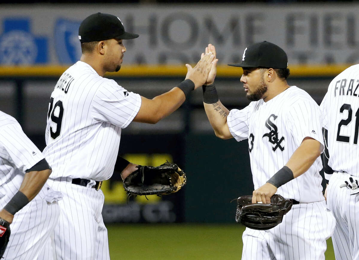 Chicago White Sox first baseman Jose Abreu (79) and Melky Cabrera celebrate the White Sox's 4-1 win over the Boston Red Sox Tuesday, May 3, 2016, in Chicago.