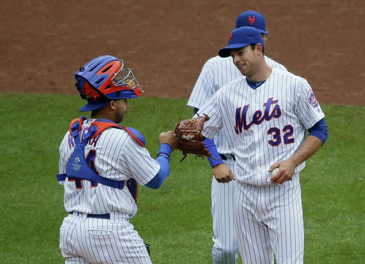 Mets catcher Rene Rivera (44) fist bumps starting pitcher Steven Matz (32) before he leaves the game during the eighth inning against the Braves Wednesday.