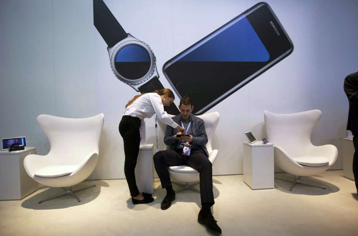 A man checks the new Galaxy S7 at the Mobile World Congress wireless show, in Barcelona, Spain.