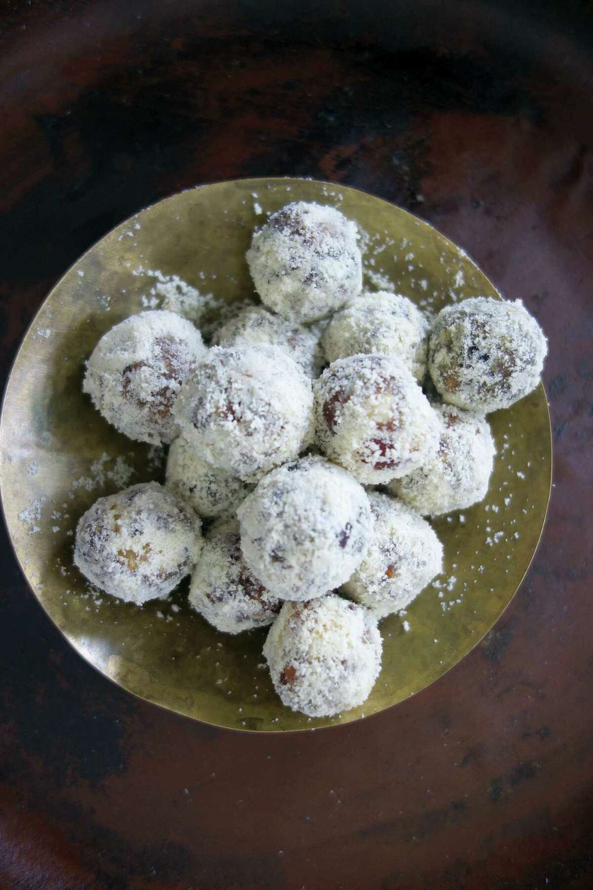 This recipe is a twist on an ancient Indian sweet recipe called khajur pak often found piled high in pyramids in Delhi sweet shops.