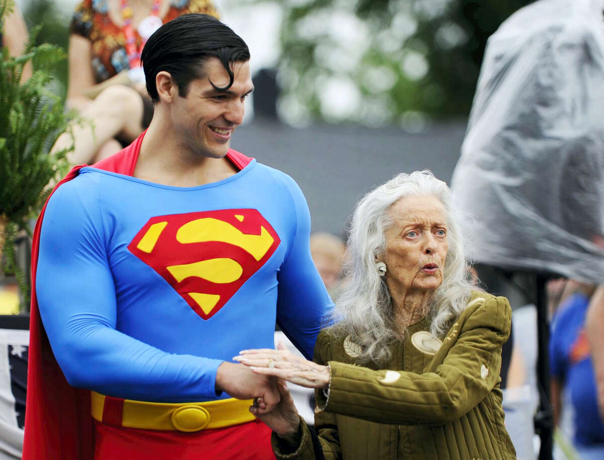 In this June 11, 2010, file photo, Noel Neill, who played Lois Lane, jokes with Josh Boultinghouse, the official superman of the Superman Celebration, during an unveiling of the Lois Lane/ Noel Neill statue in Metropolis, Ill. The actress who was the first to play Superman's love interest, Lois Lane, on screen has died. Neill was 95. Neill's biographer Larry Ward tells The Associated Press that she died Sunday, July 3, 2016, at her home in Tucson, Ariz., following a long illness.