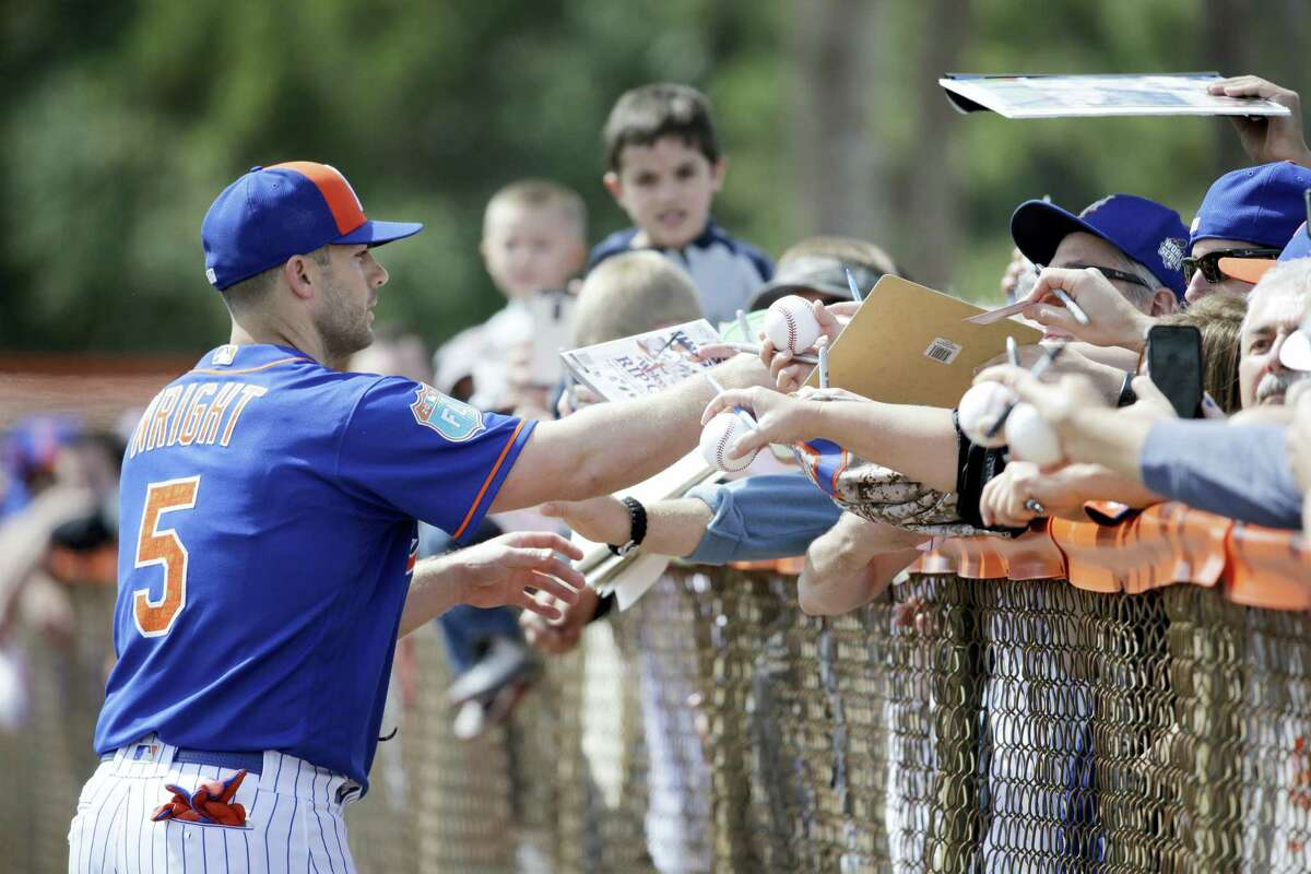 The Mets' David Wright signs autographs during spring training on Friday in Port St. Lucie, Fla.