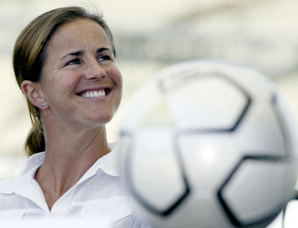 In this May 13, 2004, file photo, San Jose CyberRays soccer star Brandi Chastain is shown during a news conference in Carson, Calif. Chastain, who scored the game-winning penalty kick that gave the United States the 1999 Women's World Cup title, has pledged to donate her brain for concussion research when she dies.